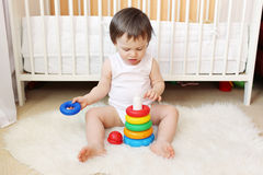 18 months baby plays nesting blocks Royalty Free Stock Images