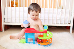 18 months baby plays toy. At home Stock Image