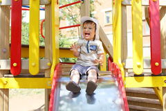 20 months child on slide Royalty Free Stock Images
