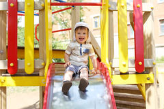 20 months child sliding on playground Royalty Free Stock Photography