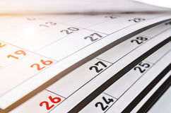 Months and dates shown on a calendar. Months and dates shown on a calendar whilst turning the pages royalty free stock image