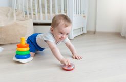 9 months old baby boy playing with toy tower at living room royalty free stock images