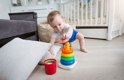 9 months old boy crawling on floor at living room and reaching f stock image