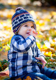 8 months old boy in the fall Royalty Free Stock Photos