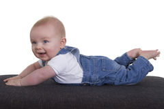 6 months old happy baby boy pushing up Royalty Free Stock Images