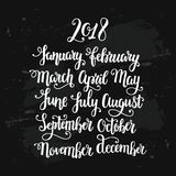 Months pf the year 2018 hand drawn lettering on distressed chalk board. Handwritten white calligraphy on black grunge background Stock Images