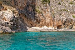 Monti Insani Crazy Mountain - Sardenia - Italy. Monti Insani - Baunei - Sardenia, Italy. Sailing to Crazy Mountain on the east coast of Sardenia. Photo taken on stock photography