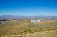 Monti John Observatory vicino alle valli Nuova Zelanda della montagna delle alpi del sud di Tekapo del lago Fotografia Stock