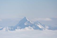 Monti la regione sopra le foschie - Austria di Dachstein Immagine Stock