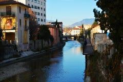 Monticato river and bridge in Conegliano Veneto, Italy. Monticato river, historical buildings and bridge, in Conegliano Veneto, in Veneto, Treviso, Italy Stock Photography