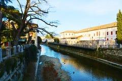Monticato river, cityscape in Conegliano Veneto, Italy Royalty Free Stock Photo