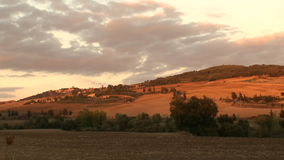 Monticchiello sunset. The road to the little town of Monticchiello as the sun sets over the Val d'Orcia in Tuscany, Italy stock footage
