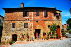Montichiello. Tuscany Italy square  sky windows cloud tower colors country road street courts green door panorama sunset Stock Photos