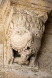 Montmajour Abbey near Arles Provence France. Monster or Tarasque Devouring a Sinner c12th Romanesque Carving in the Cloisters Montmajour Abbey near Arles Royalty Free Stock Photo
