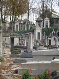 Montmartre cemetery. A view of the tombs in the Montmartre cemetery with Paris buildings in the background Royalty Free Stock Photo