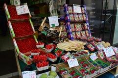 Montmartre fruit shop Paris France. Soft fruits, asparagus and berries for sale in a fruit and vegetable shop in Montmartre, Paris`s 18th arrondissement Stock Photo