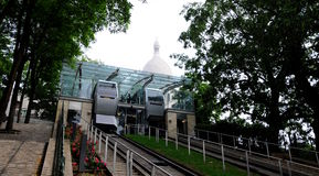 Montmartre funicular up  Sacre Coeur. The Montmartre funicular elevator with a rain protection transparent ceiling and a small garden climbing the hill Sacre Stock Photography