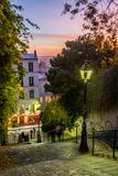 Montmartre lights and stairs at sunset. Paved staircase in a quiet street in Montmartre district in Paris stock photos
