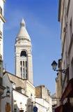 Montmartre, narrow street overlooking a Basilica Royalty Free Stock Photos