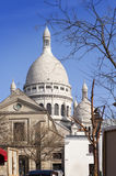 Montmartre, narrow street overlooking a Basilica of Sacre-Coeur, Paris, France Stock Images
