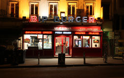 Montmartre by night. Burger cafe. Paris Stock Images