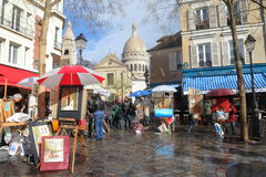 Montmartre in Paris. Famous Place du Tertre square with artists and paintings in Montmartre, Paris Royalty Free Stock Images