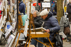 Montmartre, Paris. PARIS, FRANCE - MARCH 16 2015: artists create and sell their work on Place du Tertre in Montmartre, the area once attracted famous modern Royalty Free Stock Photos
