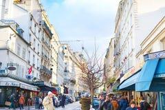 Montmartre street, Paris. PARIS, FRANCE - JAN 17, 2015: People walking on a Montmartre street. Montmartre is the famous tourist destination in Paris Stock Photo