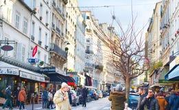 Montmartre street, Paris. PARIS, FRANCE - JAN 17, 2015: People walking on a Montmartre street. Montmartre is the famous tourist destination in Paris Stock Images