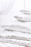 Montón de almohadillas en una ventana Fotografía de archivo libre de regalías