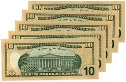 Montón de diez dólares aislados, abundancia de los ahorros Imagen de archivo