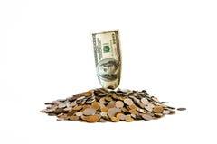 Montón de monedas y del billete de banco Fotografía de archivo