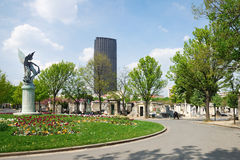 Montparnasse cemetery. Shoot of the cemetery of Montparnasse, in Paris, with the tower of Montparnasse Royalty Free Stock Image