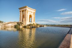 Montpellier city in France. View on the water tower in Peyrou garden with beautiful water reflection during the morning light in Montpellier city in southern stock images