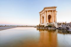 Montpellier city in France. View on the water tower in Peyrou garden with beautiful water reflection during the evening light in Montpellier city in southern stock photography