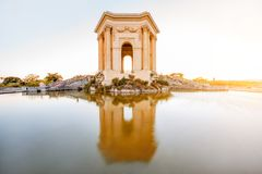 Montpellier city in France. View on the water tower in Peyrou garden with beautiful water reflection during the evening light in Montpellier city in southern stock photo