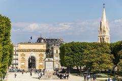 Montpellier, France. Views of the Promenade du Peyrou crowded with people, with the equestrian statue of Louis XIII, the Triumphal Arch Arc de Triomphe and the stock photos