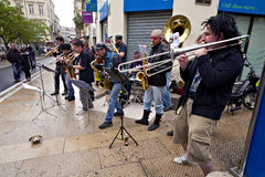 MONTPELLIER - MAY 2010: Street brass rock band. MONTPELLIER, FRANCE - MAY 2010: Street brass rock band at the rue de la loge Stock Images