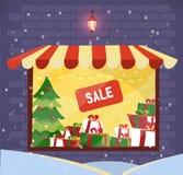 Montra com venda dos presentes do Natal na noite nevado Armazene a fachada Iluminando a janela da loja com o dossel listrado na p ilustração stock