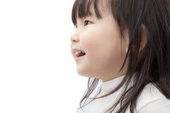 Montre asiatique et sourire de petite fille Images stock