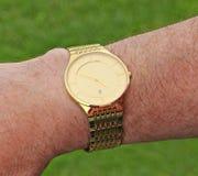 Montre-bracelet d'or de monsieurs photo libre de droits