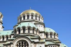 Montre de ciel au-dessus des objets religieux d'or Photographie stock libre de droits