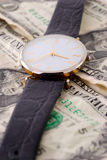 Montre et argent Photographie stock