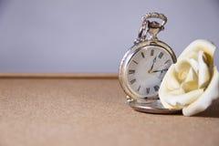 Montre et fleur de poche. Photos libres de droits