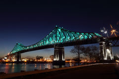 Montreal's 375th anniversary. Jacques Cartier Bridge. Bridge panoramic colorful silhouette by night. Jacques Cartier Bridge Illumination in Montreal Stock Photography