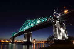 Montreal's 375th anniversary. Jacques Cartier Bridge. Bridge panoramic colorful silhouette by night. Jacques Cartier Bridge Illumination in Montreal Stock Photo