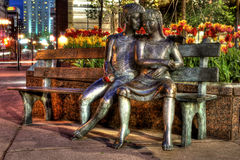 Montreal. Statue of a young couple on at bench Royalty Free Stock Photography