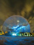Montreal Biosphere. An evening view of the blue illuminated Biosphere with moving clouds as seen in Montreal, Quebec, Canada origionally build for Expo 67 royalty free stock images