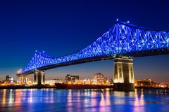Jacques Cartier Bridge is lit up in blue royalty free stock photos