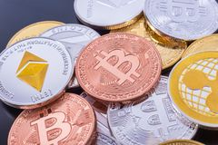 Stacked cryptocurrency coins Bitcoin, Ethereum, Ripple Royalty Free Stock Image